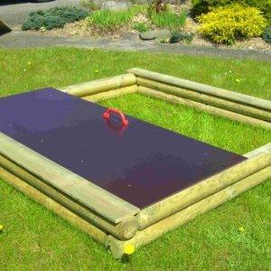 Sandkasten aus Holz mit Deckel